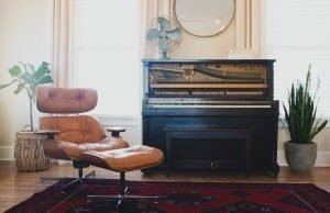 Piano and chair in living room