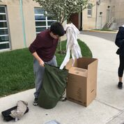 Student packs his things for the move