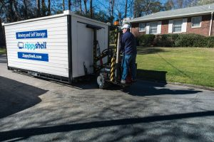 Zippy Shell portable storage container and mover with a dolly.
