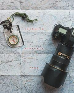 Photo camera and map - a stuff travelers store for long or short term
