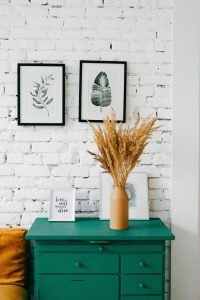 Protect Furniture in Storage from the mold, such as your green dresser with a vase on it