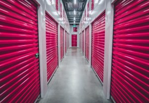 Hallway with storage units with red doors
