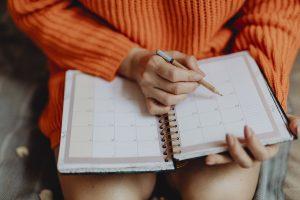 girl holding an agenda