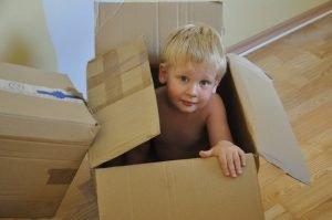 Little boy in cardboard box