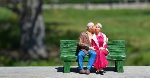figure of older couple on the bench