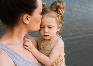 Packing tips for busy moms that kiss and hold their little girls