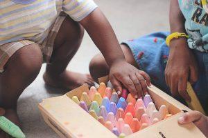 KIds packing crayons