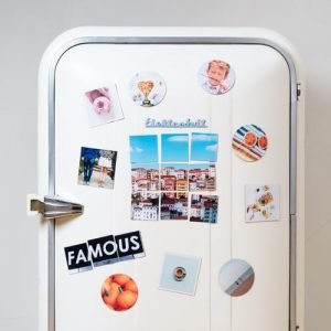 a white fridge with photos and magnets on