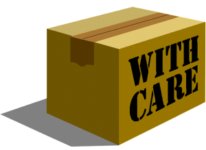 Cardboard box with labeln -with care