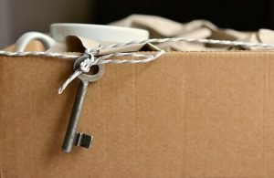 cardboard box with cup and keys