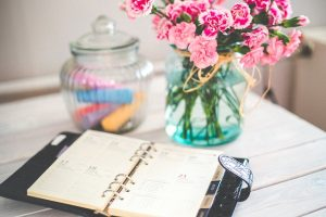 use notebook, flowers and markers to prepare for long distance move.