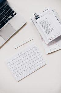 a checklist next to a computer