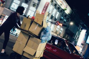 a woman pushing the boxes