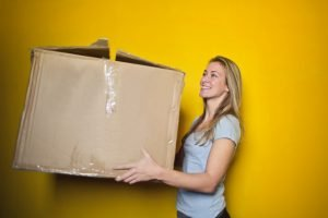 woman carrying a large box