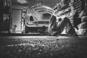 a man under the car