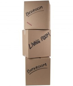 Label your storage boxes on the sides like these 3 stacked cardboard boxes that say: bedroom, living room, bathroom