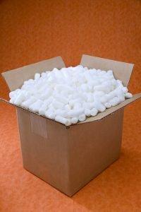 A cardboard box full of styrophoam balls