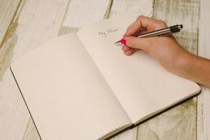 notebook-pencil-hand
