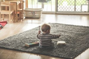 Baby playing on a carpet