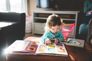 a little girl reading