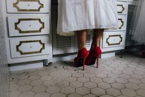 Woman in red heels packing kitchen cabinets