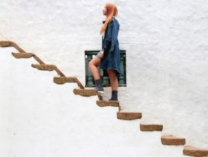 woman climbing on brown concrete stairs
