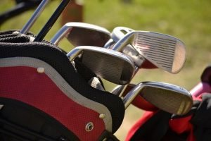 how to safely pack and move sports equipment - golf