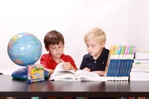 Two boys studying together.