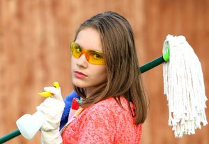 A girl prepared for serious cleaning.