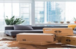 pack glasses for moving - moving boxes on the floor of the living room