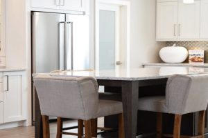 dining table with two chairs in a kitchen