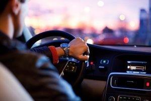A man behind a driving wheel