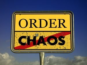 Order and Chaos crossed out on a sign