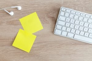 Post-it notes next to a keyboard