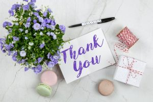 Thank you note with flowers and macaroons