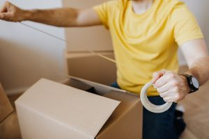 Man with packing tape