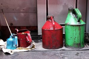 Four oil containers drying