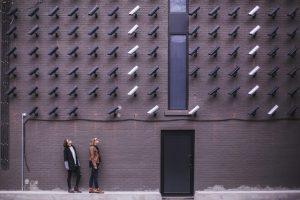 Dozens of security cameras above a black door