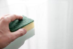 a sponge in hand