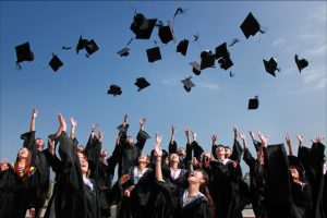 people throwing graduation hats in the air