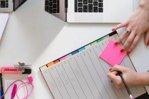 Person writing a checklist.