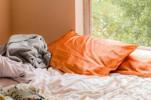 orange pillows on the bed