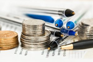 coins, pens and paper presenting a third-party insurance