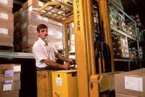 A man working in a storage unit