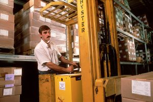 A man working in a storage facility