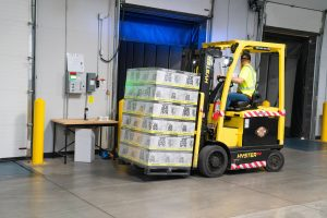 man on a yellow forklift