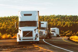 Moving trucks on road.