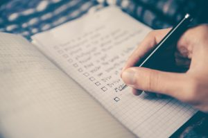 a person checking a checklist