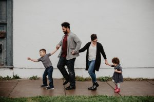 family-of-four-walking-at-the-street