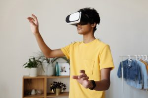 male in yellow shirt using VR
